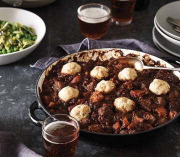Cooks delicious looking steak and ale stew with cheesy scone dumplings